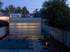 Urban garage, day and night - contemporary - Patio - Chicago - Wheeler Kearns Architects