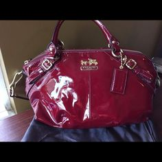 """Coach patent leather bag Known as """"the Oprah bag"""" (was on her show as one of her favorite things).Beautiful patent leather hand bag. Deep red/ox blood color. Double handle with 24"""" removable strap. Red satin interior and 3 inside pockets. 7h x 14L x 5w Coach Bags Shoulder Bags"""