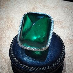 Bayco Jewels, The Imperial Collection - The Pyramid of Wisdom: A marvelous 39 carat sugarloaf cabochon Colombian emerald set in an intricate diamond micropavé ring. (=)