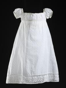 Girl's dress: Cotton plain weave (muslin) with cotton embroidery and cotton passementerie XVIIII century. Image Library   LACMA