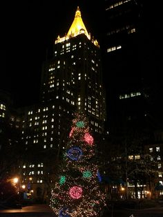 Madison Square Park Christmas Tree and The New York Life Insurance Building by christiNYCa, via Flickr