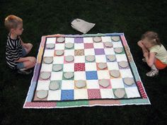 Picnic blanket / checkers board?  Could make chess pieces with appliqued or stenciled letters on top (Q, K, R, B, P etc) JJ
