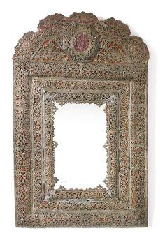 A Swedish baroque lead mirror last quarter 17th century height 27 1/2 in.; width 17 in. 70 cm; 43.5 cm