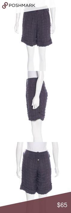"Nina Ricci dusty navy silk textured shorts Charcoal Nina Ricci silk knee-length shorts with texture throughout, dual pockets at hips and button closures at front.  Inseam: 8"" Waist: 28"" Leg Opening: 22"" Rise: 12"" Hip: 36""  Fabric: 98% Silk, 2% Elastane; Combo 100% Viscose Designer: Nina Ricci  *all photos are of the actual item  *size 36 or US size 4 Nina Ricci Shorts Bermudas"