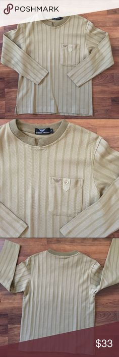 "Mens Giorgio Armani LS Size L Shirt EUC Shirt is like new and is from Giorgio Armani and is a size L. It belonged to my nephew and he bought it while traveling abroad and only wore a handful of times. It's free of any rips tears or stains and has a pocket on the front chest with an embroidered Armani logo. Shirt is 100% cotton, length is 23"" and pit to pit across the back measures 17.5"". It's a slim fit. Thank you for looking! ☺ 🚫trades 🚫lowball offers Giorgio Armani Shirts"