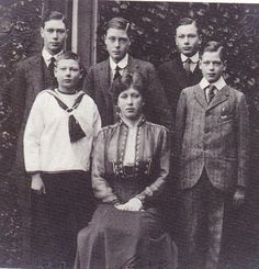 The 6 children of King George V and Queen Mary. David, later King Edward VII and Duke of Windsor, middle back row. Bertie, future King George VI, is back row, left end.