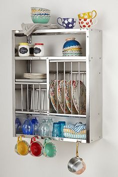 Anthropologie Kitchen Utensil Rack: This steel kitchen utensil rack ($298) is a great way to utilize the wall to store items in tiny kitchens. While the rack is neutral in color and tone, it can easily be dazzled up with colorful plates, kitchen towels, cups, and spice jars. — AMR