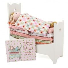 Maileg The Princess And The Pea Set - Maileg The Pricess And The Pea set comes with seven multi-patterned matresses, a floral quilt and checked pillow, a white wooden bed frame, a knitted princess doll, a pea and an illustrated book. The set measures 27cm x 30cm x 11cm. Suitable for children aged three years and above.