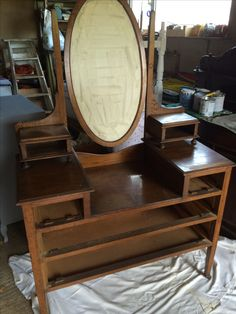 Rescued from the dumpster. lol the drawers were complete just not shown in this picture. It's a lovely size dressing table on its original casters.