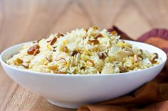 Fragrant Saffron Rice with Golden Raisins and Pine Nuts make a wonderful side dish to any meal! This simple rice dish is loaded with spice and texture, then