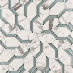 spring petite mosaic in abalone blue clear glass and statuario stone made by Ann Sacks. Part of Liberty collection. Used for all wall applications. Geometric pattern creates an interesting design.  Glass tiles create shadows enhancing three dimensional design.