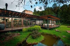 Situated in the middle of the Valle de Bravo forest, San Sen House is a  stilt house with a metallic structure incased in wood and glass. The  home is surrounded by a lush forest, and is designed