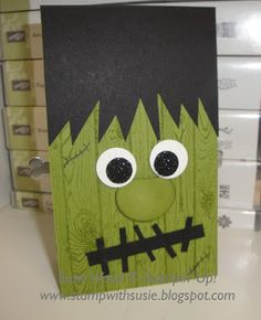handmade Halloween card vrom Stamp with Susie ... punch art styling ... Frankenstein head in green and black ... luv the black glitter paper eyes ... hardwood grain stamped for texture ... fab card! ... Stampin' Up!