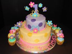 cute flowers 1st birthday cake and cupcakes for girls