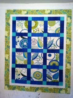 Blue and green quilt. I love the way it's set up