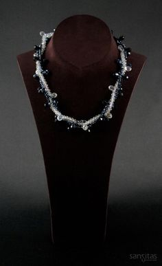 Upendo White and Blue - A multi-stranded charmer comprised of both briolette and teardrop shaped crystals. Versatile enough to transform day to evening wear, its sure to be a complement to any wardrobe!
