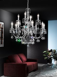 FL2155/12 Taffeta 12 light chandelier, chrome and crystal. Tradition chandelier with a modern twist, chroem finish fitting with square section arms, crystal column and crystal glass drops. Set over two tiers. 1 x 60w E14 Candle Lamps not included Height- 137cm Minimum Height- 85cm Diameter- 76cm BRAND: Franklite  REFERENCE: FL2155/12 AVAILABILITY: 3-4 Working Days