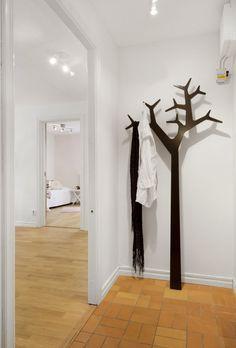 Useful art.  Tree towel holder!