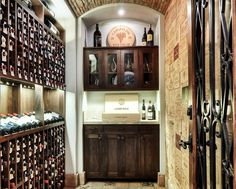 Gorgeous wine cellar with wine crate panel wall tiles opposite the rack - www.designworkshome.com