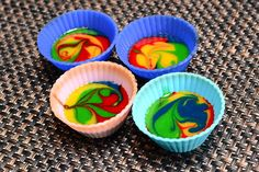 Tie Dye Cupcakes! Delicious, fun & easy! Learn how...Grade: A    Review: I've wasted years making plain-colored cupcakes!  Awesome, impressive, and a hoot for the kids.  Vary the colors according to season/holiday and you have an easy custom dessert.