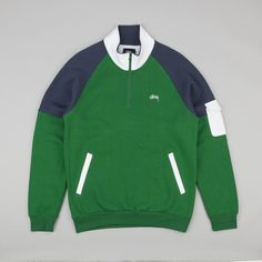 Track top in Green from Stussy,featuring a panelled design with a high collar quarter zip and Stussy signature embroidered branding on the front....