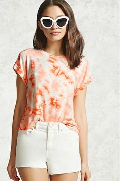 A semi-cropped knit tee featuring a crystal dye design, round neckline, and short cuffed sleeves.