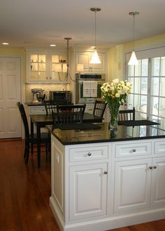 white cabinets with dark floors | White cabinets, wainscotting and trim and dark blue granite counters ...