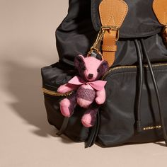 A Burberry charm featuring Thomas Bear, our signature teddy, in soft tonal check cashmere. The design features moveable arms and legs, and a bow detail.