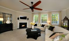 Remington Family Room  #livingroom #ceilingfan #whitecouch #fireplace #carpet #familyroom #decorating