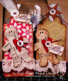 Gingerbread men out of aged sheet music; button attached to ribbon at top