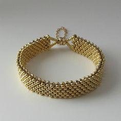 Handmade Beaded Jewelry And Lampwork Jewelry Designs - Pacificjewelrydesigns.com - Band of gold beaded bracelet
