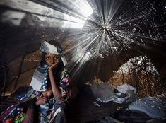 """""""Photograph by @JohnStanmeyer  Bearing Witness ~ The Refugee Crisis  Early December 2008 ~ Aisha Barka and her daughter, Mariam, hadn't eaten in days.…"""""""