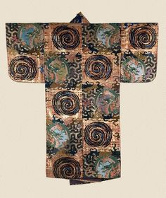 http://www.artgallery.nsw.gov.au/collection/works/286.2006/# Nô theatre costume Other titles: Noh theatre costume Place of origin Japan Period Edo (Tokugawa) period 1615 - 1868 → Japan Year circa 1800 Media category Textile Materials used silk and gold; ikat dyed threads for the warp; brocade weave using flat strips of gilt paper