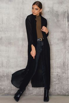 Drape it over and head on out! Sheer Maxi Trench Coat by NA-KD comes in black and features split at back, trench design and rope belt. Style this with high waisted jeans, cropped top and high heels for a killer look!