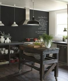 Kitchen! Chalkboard paint + stainless + wood floors + write + DIY barnboard kitchen island on wheels so it can also function as a serving cart:
