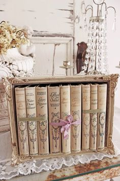 Easy to make yourself? Cardbordbox, pictureframe in front, paint, books in, done? need to try this!