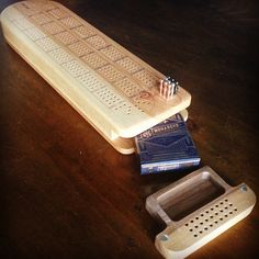 Custom cribbage board with pocket for cards and peg storage. #cnc #laser