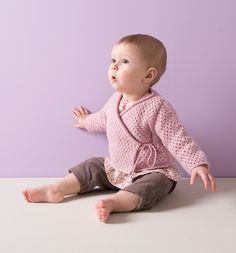 Cute baby wrap-around pink cardigan! Download the free pattern on LoveKnitting.com
