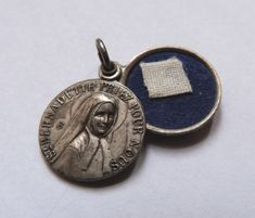 Rare Antique French religious miraculous relic medal w saint Bernadette Soubirous w text, religious reliquary pendant icon locket w fabric.