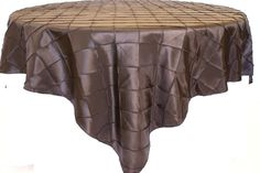 Chocolate Pintuck Table Overlay provided by Waterford Event Rentals.