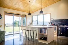 A simple functional design combiningconcrete, Oak and Lino. A contemporary take on a farmhouse style kitchen.