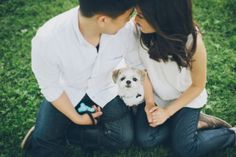 A couple and their dog during their engagement session in DUMBO with NYC wedding photographer Ben Lau.