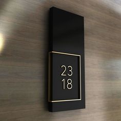 The unit number in painted acrylic and brushed brass. More