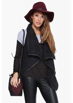 An comfy and cozy faux fur vest! This would be great for layering to wear on a cold night