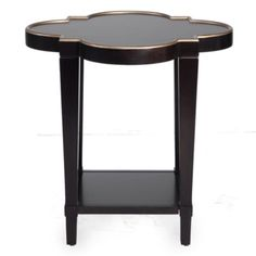 Versatility, function and style combine perfectly in our Addison End Table. The scalloped table top trimmed in a soft gold adds a layer of elegance to this design. Available in parchment or espresso wood finishes.