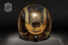 Studs, wrought iron, textiles, decorations...  The typical elements that characterize the original appearance of the ancient Samurai armor are gathered here.    After a study and a careful design comes this original and aggressive helmet airbrushed on a complete coverage in antiqued gold leaf.
