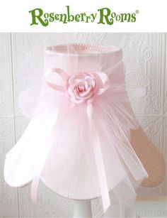 Your little one will simply adore this sweet lamp shade!  The luxurious dupioni silk bell-shaped shade is adorned with a pretty tulle bow and a pink Mulberry paper rose