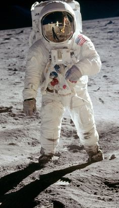 Astronaut Buzz Aldrin, photographed by Neil Armstrong (visible in reflection).
