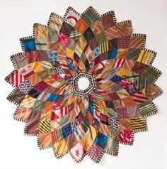 Tree skirt. Inspired by a Spira-graph pattern. Fabricated from discarded silk ties and scarves.