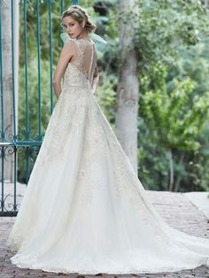 Maggie Sottero Ball Gown with an Illusion neckline. Kleinfeld Bridal Mobile - The Largest Selection of Wedding Dresses on the go!